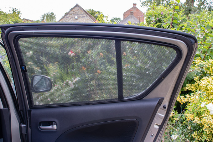 Rear window of a car fitted with a carshade